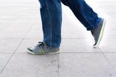 Man in blue jean. Walking Royalty Free Stock Images