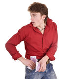 Man in blue jeans with money. Royalty Free Stock Image