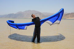 Man with blue kite royalty free stock image