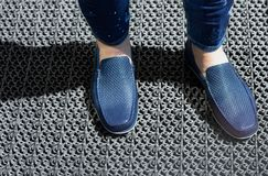 A man in blue jeans and moccasins. Blue moccasins of leather stock photos
