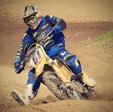 Man in Blue Motorcycle Suit Riding on Yellow Dirt Motorcycle during Daytime Royalty Free Stock Images