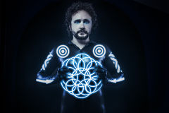 Man with blue neon lights, the future warrior costume, fantasy s Stock Image