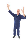 Man in blue overall cheering Royalty Free Stock Images