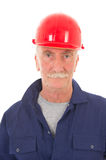 Man in blue overall with red helmet Royalty Free Stock Images