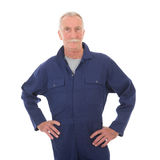 Man in blue overall Royalty Free Stock Image