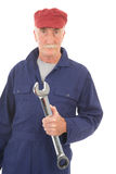 Man in blue overall with wrench Stock Photos