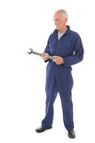 Man in blue overall with wrench Royalty Free Stock Photo