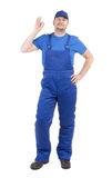 Man in blue overalls show ok sign. Stock Photos