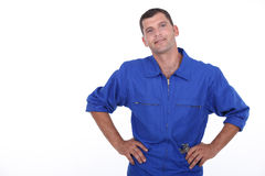 Man in blue overalls Royalty Free Stock Photography