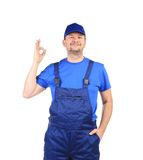 Man in blue overalls Royalty Free Stock Images