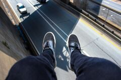 Man in Blue Pants Wearing Black and White Lace Up Low Top Sneakers Stock Photos