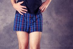 Man in blue plaid boxer shorts stock photo