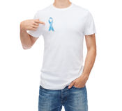Man with blue prostate cancer awareness ribbon Royalty Free Stock Photos
