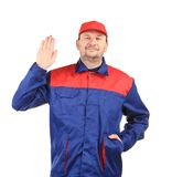 Man in blue and red overalls Stock Photography