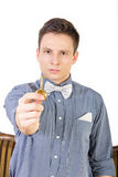 Man in a blue shirt with a bow tie holds the key Royalty Free Stock Image