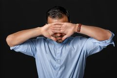 Man covers his face with his hands stock photos