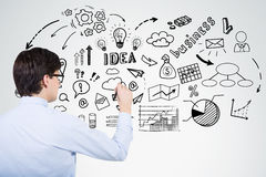 Man in blue shirt drawing business idea sketch Royalty Free Stock Photo