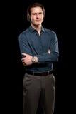 Man in Blue Shirt and Grey Slacks. Studio shot over black Stock Photo
