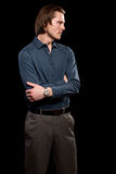 Man in Blue Shirt and Grey Slacks. Studio shot over black Stock Photos