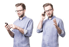 Man in blue shirt holding mobile phone smartphone Royalty Free Stock Photography