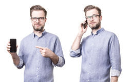 Man in blue shirt holding mobile phone smartphone Stock Photos