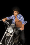 Man blue shirt motorcycle black blow Royalty Free Stock Photography