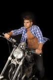 Man blue shirt motorcycle black blow Royalty Free Stock Photography