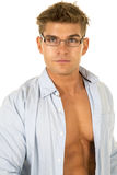 Man blue shirt open in glasses looking close Stock Images