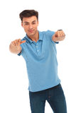 Man in blue shirt pointing with both hands Royalty Free Stock Photos