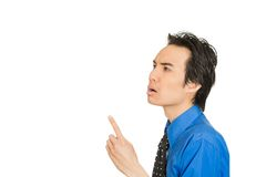 Man in blue shirt pointing finger up he solved problem Royalty Free Stock Photography