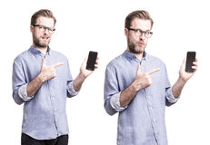 Man in blue shirt pointing at mobile phone smartphone stock photo