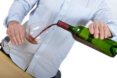 A man with a blue shirt serves a glass of red wine Royalty Free Stock Photos