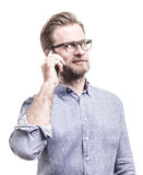Man in blue shirt talking on mobile phone smartphone Stock Photos