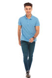 Man in blue shirt walking to the camera Stock Image