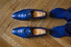 Man with blue shoes close up Royalty Free Stock Photography
