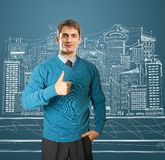 Man in blue shows well done Royalty Free Stock Image