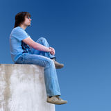 man on a blue sky background Stock Images