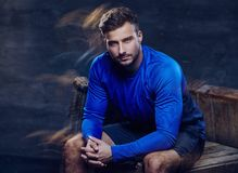 A man in blue sports jersey. A man in shorts and blue sport jersey. in studio Royalty Free Stock Photos