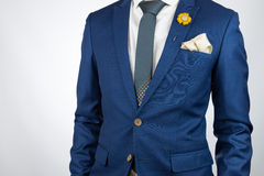 Man blue suit necktie, brooch, pocket square Royalty Free Stock Photo