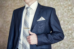 Man in blue suit. With tie, tie clip and handkerchief stock photos