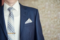 Man in blue suit. With tie, tie clip and handkerchief. Focused on handkerchief stock images
