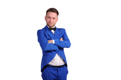 Man in blue suite with incredulous face  on white background Royalty Free Stock Image