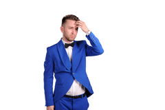 Man in blue suite with incredulous face  on white background Royalty Free Stock Photography