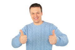 Man in blue sweater makes gestures by fingers Royalty Free Stock Image