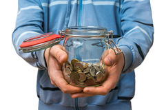 Man in blue sweatshirt holding money jar with coins. Isolated on white background stock image