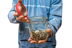 Man in blue sweatshirt holding money jar with coins. Isolated on white background royalty free stock photos