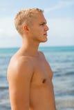 Man in blue swim shorts in the beach Stock Photos