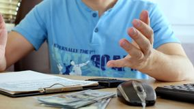 Man in blue T-shirt explaining something and gesturing. By hands stock video footage