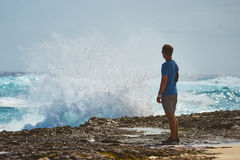 Man in Blue T-shirt Standing Near Seashore Stock Photo