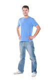 Man in blue t-shirt standing over white Stock Photos